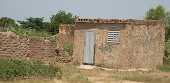 In an informal settlement, a house marked for demolition after the completion of water supply network. Residents received a land title to be relocated