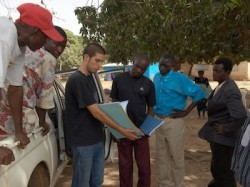 Reviewing documents with local partners in Ougadougou